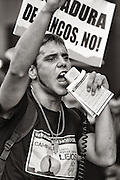 A young protester shouting slogans against banks and financial institutions