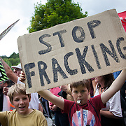 Young boys show their oppinions on fracking. Thousands turned out for a march of solidarity against fracking in Balcombe. The village Balcombe in Sussex is the  centre of fracking by the company Cuadrilla. The march saw anti-fracking movements from the Lancashire and the North, Wales and other communities around the UK under threat of gas and oil exploration by fracking.