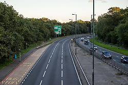 Licensed to London News Pictures. 27/09/2021. Dorking, UK. A very quiet rush hour on the A3 Kingston Bypass south-west London this evening (18:17), a major road in and out of the Capital and usually synonymous with long tailbacks as motorists continue to struggle to find petrol stations with fuel. Large queues have formed at petrol stations across the country over the weekend with many running out of fuel as oil giants struggle to maintain deliveries due to the lack of HGV drivers. Photo credit: Alex Lentati/LNP