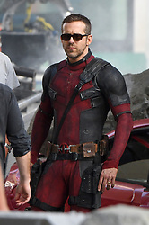 Ryan Reynolds joins Zazie Beetz back on set filming action scenes for Deadpool 2. Ryan was seen in-between takes wearing the deadpool costume with no mask on and sunglasses. Ryan chatted to Zazie Beetz as she arrived on set and prepared for filming as other cast including Colossus was seen filming in downtown Vancouver. Deadpool 2 production had been on hold while the investigation into a fatality on set involving a stunt woman for Zazie Beetz. 16 Aug 2017 Pictured: Ryan Reynolds. Photo credit: Atlantic Images/ MEGA TheMegaAgency.com +1 888 505 6342
