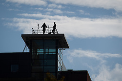 © Licensed to London News Pictures . 29/09/2013 . Manchester , UK . Armed police spotters on a high vantage above Manchester Central . The Conservative Party Conference at Manchester Central . Photo credit : Joel Goodman/LNP