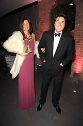 BRYAN FERRY and AMANDA SHEPPARD at The Love Ball hosted by Natalia Vodianova and Lucy Yeomans to raise funds for The Naked Heart Foundation held at The Round House, Chalk Farm, London on 23rd February 2010.