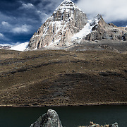 The almost triangular shaped Mt Jurau in the background is mimicked and matched in shaped by a rock in the foreground, and a greenish lake is in the middle creating separation.