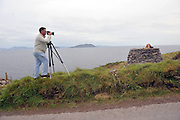 21-9-2012: Noelle Campbell Sharp, founder of the Cill Rialaigh Art project, is photographed by Don MacMonagle in a  'Cairn' made and unveiled in her honour in Ballinskelligs, County Kerry on Friday. The villahe has housed thousands of artists from all over the world during the past 21 years. The Cairn, a pile of rock on a sacred space overlooks The Hogs Head and Scarriff Islands and will be used by artists for inspiration in their work..Picture by Don MacMonagle
