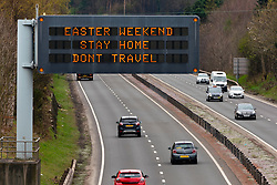 East Lothian, Scotland, UK. 9 April 2020. Overhead message board above the A1 in East Lothian warns motorists not to travel over the forthcoming Easter bank holiday weekend. Iain Masterton/Alamy Live News.