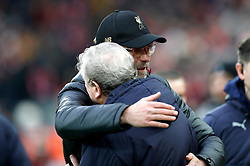 Liverpool manager Jurgen Klopp (left) and Crystal Palace manager Roy Hodgson embrace prior to kick-off during the Premier League match at Anfield, Liverpool.