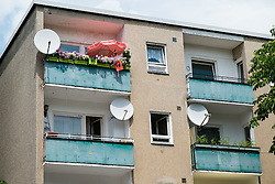 Balconies of social housing apartment building in Neukolln Berlin Germany