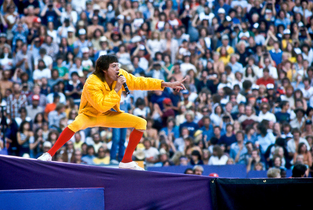 Limited Edition of 25 Includes All Sizes. Mick wears yellow jacket and knicker with red socks at Folsom Stadium in Boulder Colorado in 1981