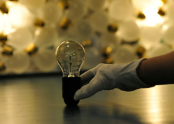 © Licensed to London News Pictures. 08/11/2011. London, UK. Kate Poulter, a science museum member of staff,holds a lightbulb featured in the exhibition. Hidden Heroes photocall at the Science Museum, London today 8th November 2011. The exhibition celebrates everyday items and is open from 9th November 2011. Photo credit : Stephen Simpson/LNP