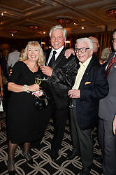 Left to right, LESLEY LEAR, JESS CONRAD and BARRY CRYER at the 90th birthday party for Nicholas Parsons held at the Hyatt Churchill Hotel, Portman Square, London on 8th October 2013.