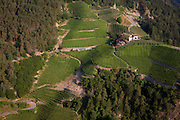 Vineyards and farm below near the South Tyrolean town of Klausen-Chiusa in northern Italy.