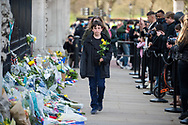 A young boy brings flowers to lay In memory of Prince Philip The Royal Highness the Duke of Edinburgh, London on 9 April 2021.