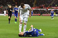 Chelsea player Eden Hazard lies injured as Swansea's Federico Fernandez looks on.  Barclays Premier League match, Swansea city v Chelsea at the Liberty Stadium in Swansea, South Wales on Saturday 17th Jan 2015.<br /> pic by Andrew Orchard, Andrew Orchard sports photography.