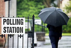 A voter arrives at the polling station in St Nicolas Parish Hall, Belfast, as voting gets underway in the 2017 General Election.