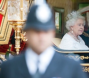 © Licensed to London News Pictures. 04/06/2014. Westminster, UK  Queen Elizabeth II being driven down The Mall in the new Diamond Jubilee State Coach after  attending the State Opening of Parliament on June 4th 2014 in London. In a speech to Members of Parliament and Peers in The House of Lords, Queen Elizabeth II will officially open a new session of parliament, which will set out the government's agenda and legislation for the coming year.. Photo credit : Stephen Simpson/LNP