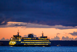United States, Washington, Seattle, ferry on  Elliott Bay at sunset