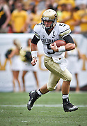 SHOT 9/1/13 4:33:31 PM - Colorado quarterback Connor Wood #5 runs with the ball against Colorado State during the 2013 Rocky Mountain Showdown at Sports Authority Field at MiIe HIgh Stadium in Denver, Co. Colorado won the annual in-state rivalry 41-27. (Photo by Marc Piscotty / © 2013)