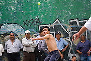Men play Fronton, elsewhere known as International Handball, Basque Pelota or Jai Alai, in an outdoor court in Mexico City, Mexico on June 17, 2008. Basque pelota, which includes variations played with hands, a racket, a bat or a basket propulsor, is popular in parts of Europe, especially the Basque Country,  Latin America and the United States.
