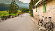 Bicycle and weathered wall (cyclists on road), Northern Velebit National Park, Croatia