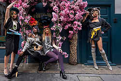© Licensed to London News Pictures. 28/11/2020. LONDON, UK.  Models take part in a flashmob through the West End for designer Pierre Garroudi.  Photo credit: Stephen Chung/LNP