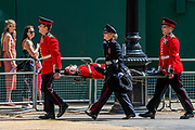 Two guardsmen faint and are stretchered off, still with gravel on their faces - The parade on Horse Guards - His Royal Highness the Duke of York reviews the final rehearsal for the Trooping the Colour on Horseguards Parade and the Mall.