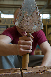 A prisoner learning the building trade in a workshop at HMP Featherstone