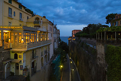 Sorrento, Italy, September 13 2017. A steep switchback road cut into the rock leads to the harbour in Sorrento, Italy is shaded from the early morning light.© Paul Davey