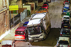 A bin lorry falls into a sink hole on Murano Place in Edinburgh just before 10pm