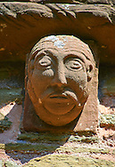 Norman Romanesque exterior corbel no 82 - sculpture of mans head with a moustache and beard similar to no 79. The Norman Romanesque Church of St Mary and St David, Kilpeck Herefordshire, England. Built around 1140 .<br /> <br /> Visit our MEDIEVAL PHOTO COLLECTIONS for more   photos  to download or buy as prints https://funkystock.photoshelter.com/gallery-collection/Medieval-Middle-Ages-Historic-Places-Arcaeological-Sites-Pictures-Images-of/C0000B5ZA54_WD0s