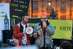 © Licensed to London News Pictures. 29/03/2018. London, UK. Cambridge Analytica whittleblower CHRISTOPHER WYLIE (right) speaking at a demonstration held by Fair Vote, outside the Houses of Parliament in London, calling for a fair vote on the EU referendum. Whistleblowers Shahmir Sanni and Christopher Wylie both spoke at the event attended by a small number of people.. Photo credit: Ben Cawthra/LNP