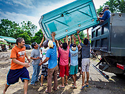 29 JANUARY 2018 - GUINOBATAN, ALBAY, PHILIPPINES: A portable toilet is delivered to the shelter for evacuees from Mayon volcano at Mauraro National High School in Guinobatan. There are 1,773 people in the shelter. Mayon volcano's eruptions continued Monday. At last count, more 80,000 people have been evacuated from their homes of the slopes of the volcano and are crowded into shelters in communities outside of the danger zone.    PHOTO BY JACK KURTZ
