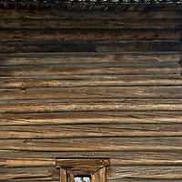 Intricate shingles and a tiny window punctuate the wall of an historic house relocated to the Malye Korely outdoor museum, near the northern port of Arkhangel'sk.