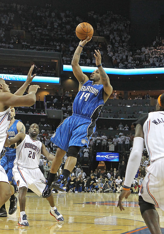 CHARLOTTE - APRIL 24:  Guard Jameer Nelson #14 of the Orlando Magic shoots a fade away shot during the game between the Charlotte Bobcats and the Orlando Magic during Game Three of the Eastern Conference Quarterfinals during the 2010 NBA Playoffs at Time Warner Cable Arena on April 24, 2010 in Charlotte, North Carolina. NOTE TO USER: User expressly acknowledges and agrees that, by downloading and/or using this photograph, user is consenting to the terms and conditions of the Getty Images License Agreement.  (Photo by Mike Zarrilli/Getty Images) *** Local Caption *** Jameer Nelson