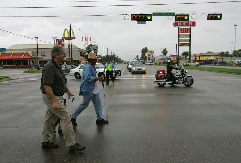 Brownsville Police officers block the intersection of Boca Chica and Central so Jay Johnson Castro and his supporters can walk through on Wednesday, the final day of the protest walk.  Reporter Steve Taylor is at left.