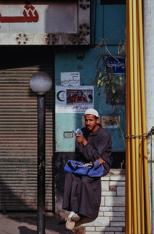 Portrait of moslem man reading Koran, Cairo, Egypt 1989
