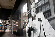 Famous old black and white photograph of Noel Coward used on a hoarding outside a theatre under redevelopment in the West End on 25th February 2020 in London, United Kingdom. Sir Noel Coward was an English playwright, composer, director, actor and singer, known for his wit, flamboyance.
