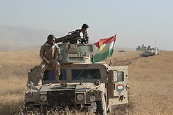 20/10/2016. Bashiqa, Iraq. Peshmerga fighters sit on an armoured Humvee mounting a MILAN anti-tank guided weapon system as they advance toward ISIS positions during an offensive to retake the Islamic State held town of Bashiqa, Iraq, today (20/10/2016).<br /> <br /> Launched in the early hours of today with support from coalition special forces and air strikes, the attack is part of the larger operation to retake Mosul from the Islamic State, and involves both the Kurds and the Iraqi Army. The city of Bashiqa, around 9 miles north of Mosul, is one of several gateway areas that must be taken before any attempted offensive on Mosul itself.<br /> <br /> Despite the peshmerga suffering several casualties after militants fought back using mortars, heavy machine guns and snipers, the Kurdish forces were quickly taking ground with Haider al-Abadi, the Iraqi prime minister, stating that the operation to retake Mosul was progressing faster than expected. Photo credit: Matt Cetti-Roberts/LNP