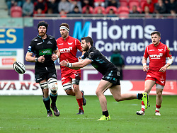 Glasgow Warriors' Tommy Seymour gets the ball away<br /> <br /> Photographer Simon King/Replay Images<br /> <br /> Guinness PRO14 Round 19 - Scarlets v Glasgow Warriors - Saturday 7th April 2018 - Parc Y Scarlets - Llanelli<br /> <br /> World Copyright © Replay Images . All rights reserved. info@replayimages.co.uk - http://replayimages.co.uk