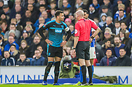 Hal Robson-Kanu (Capt) (West Brom), Lee Mason (Referee) & Jurgen Locadia (Brighton) in conversation after awarding a yellow card to Locadia during the FA Cup fourth round match between Brighton and Hove Albion and West Bromwich Albion at the American Express Community Stadium, Brighton and Hove, England on 26 January 2019.