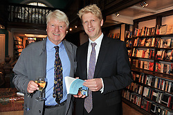 Left to right, STANLEY JOHNSON and his son JOSEPH JOHNSON at a party to celebrate the publication of Stanley Johnson's new book 'Where The Wild Things Were' held at Daunt Books, 83 Marylebone High Street, <br /> London W1 on 18th July 2012.