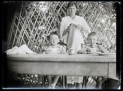 mother cutting bread for the children France 1923