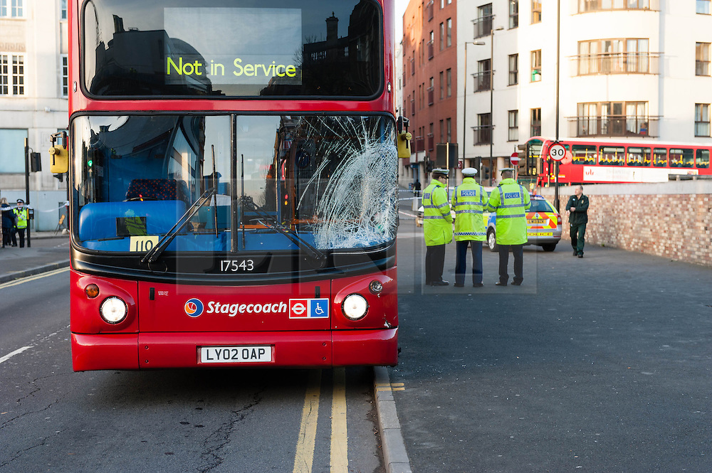 © Licensed to London News Pictures. 25/11/2013. London, UK. The accident scene where a bus collided with a pedestrian at rush hour this morning in Farringdon, central London. The smashed bus window shows the point of impact.Photo credit : Richard Isaac/LNP