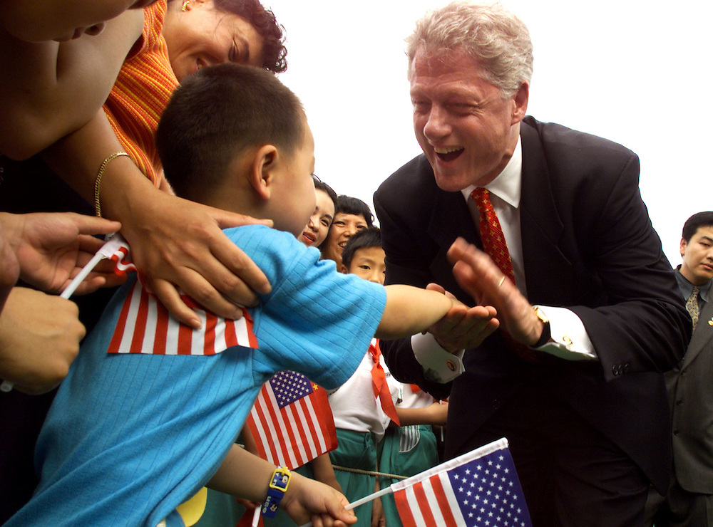 SHA14D:CHINA-CLINTON:SHANGHAI,CHINA,1JUL98 - U.S. President Bill Clinton greets Youghuan Ren, age four, during a visit to the Jin Hui Gardens housing project July 1. Clinton addressed new home owners at the site.   ptb/Photo by Rick Wilking   REUTERS