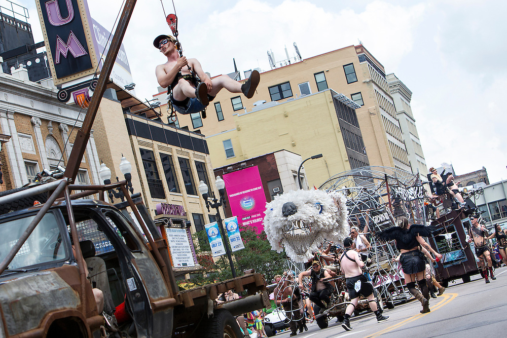Jordan Sullivan hangs from a vehicle representing First Avenue during the 2015 Ashley Rukes GLBT Pride Parade in Minneapolis June 28, 2015.
