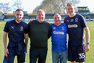 AFC Wimbledon manager Wally Downes, AFC Wimbledon goalkeeper Aaron Ramsdale (35), AFC Wimbledon defender Steve Seddon (15) with AFC Wimbledon fan during the EFL Sky Bet League 1 match between AFC Wimbledon and Charlton Athletic at the Cherry Red Records Stadium, Kingston, England on 23 February 2019.