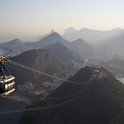 Cable cars taking tourists and sightseers to and from the top of Sugar Loaf Mountain, one of the iconic tourist destinations in Rio de Janeiro. Rio de Janeiro, Brazil. 9th September 2010. Photo Tim Clayton.