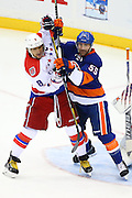 21 APR 2015: Washington Capitals left wing Alex Ovechkin (8) battles New York Islanders defenseman Johnny Boychuk (55) during the first period of the  Round 1 game 4 2015 Stanley Cup Playoff game between the New York Islanders and the Washington Capitals played at Nassau Veterans Memorial Coliseum in Uniondale,NY. The New York Islanders defeat the Washington Capitals 2-1 in overtime.