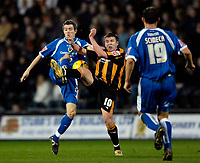 Photo: Jed Wee.<br />Hull City v Cardiff City. Coca Cola Championship. 16/12/2006.<br /><br />Cardiff's Kevin McNaughton (L) and Hull's Stephen McPhee battle for possession.