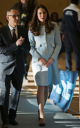 © London News Pictures. 19/01/2015. London, UK. A pregnant Catherine, Duchess of Cambridge wearing baby blue during a visit to formally open Kensington Leisure Centre in West London. Photo credit: Ben Cawthra/LNP