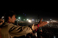 Imran Khan, chairman of the Pakistan Tehreek-e-Insaf, gestures as he speaks to the crowd from the stage during an election campaign rally in Multan, Pakistan, Monday, May 6, 2013. Pakistan is due to hold a general election on May 11, the first transition of power between democratically elected governments.